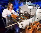 ARS scientist casting carrot wrap into rolls