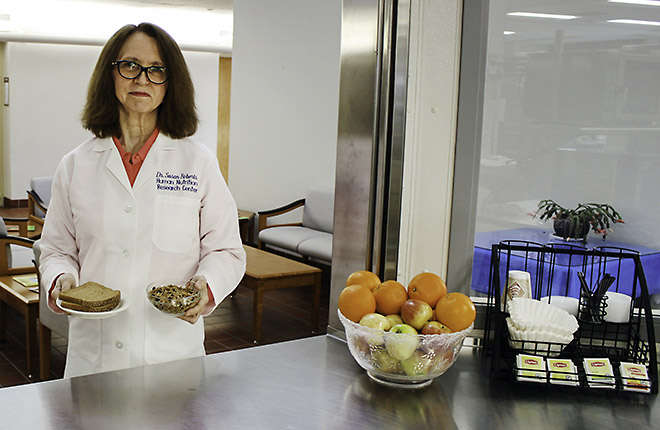 Scientist holding whole-grain foods used in study