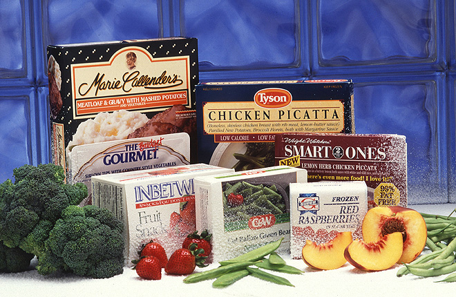 Boxes of frozen/processed foods, along with fresh fruits and vegetables