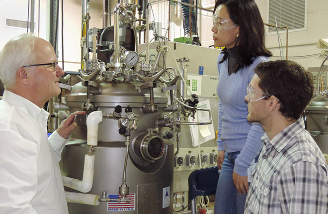ARS Microbiologist Mark Jackson (left) and Brazilian collaborators, seed physiologist Nilce Kobori (center) and entomologist Gabriel Mascarin (right).