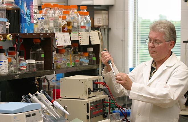 Scientist prepares enzymes.