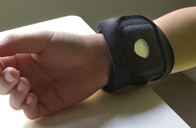 Wristband monitor on study participant.