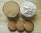 Cookies in front of bowls of amaranth seeds and amaranth flour