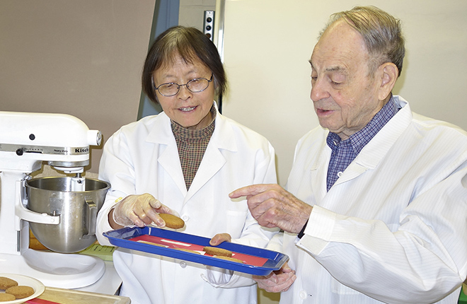 Scientists in lab inspecting cookies made with amaranth and oat products