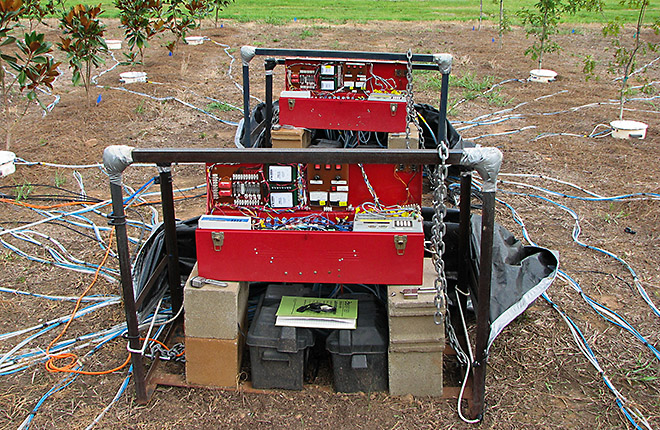 Automated Carbon Efflux System control box with wires and sensors leading to plants